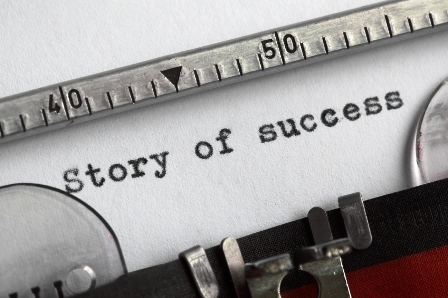 Story of success written on an old typewriter